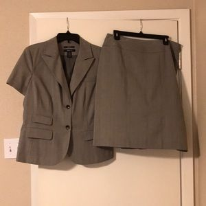 Two piece suit. Jacket is a size 12/skirt size 10